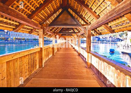 Chapel bridge (Kapellbrucke) historic wooden bridge in Luzern, town in central Switzerland