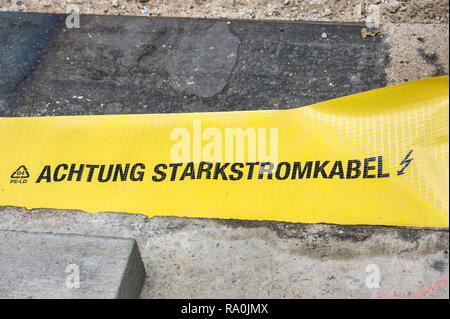 _achtung starkstromkabel_; _attention, high voltage power cable_ - Stock Photo