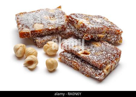 Turkish dessert cezerye with hazelnuts isolated on white background