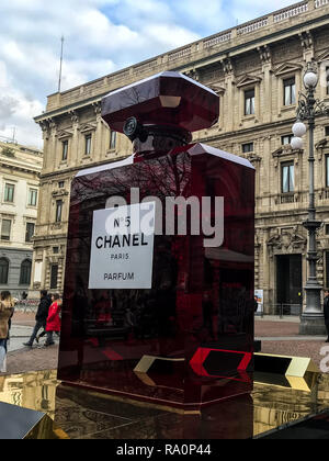 A giant bottle of Chanel perfume placed in front of Palazzo Marino, headquarters of administrative office of Milano - Stock Photo