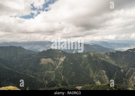view from Poludnica hill in Nizke Tatry mountains in Slovakia during autumn day with blue sky and clouds - Stock Photo