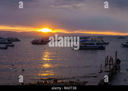 sunset over lake titicaca in bolivia - Stock Photo