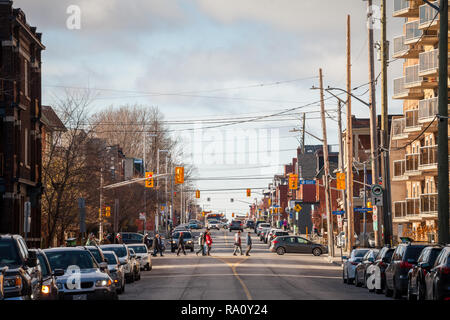 OTTAWA, CANADA - NOVEMBER 11, 2018: Typical north American residential street in autumn in Centretown, Ottawa, Ontario, during the afternoon with cars - Stock Photo