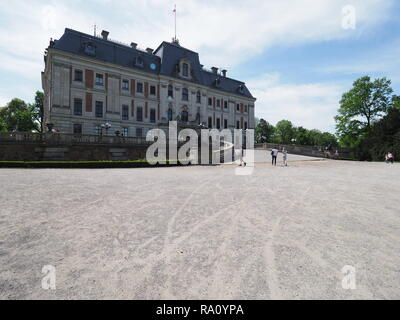 Antique neo baroque castle museum and courtyard at park of european Pszczyna city in Poland with cloudy blue sky in 2018 warm sunny spring day on May. - Stock Photo