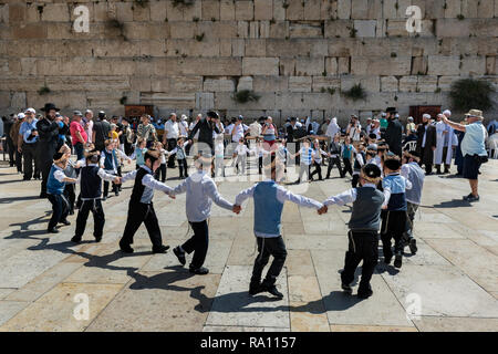 Young Jewish visitors at the Western Wall in Jerusalem. Israel - Stock Photo