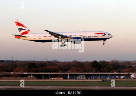 British Airways Boeing 777-200ER landing at Heathrow airport, Terminal 5, London UK - Stock Photo