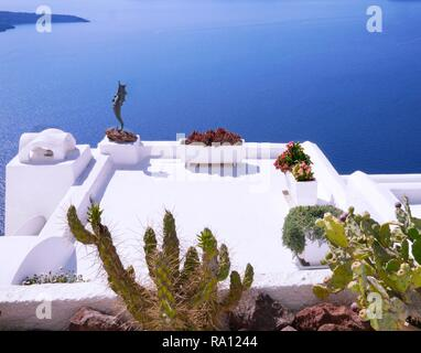 Aegean Sea view over a rooftop garden in the village of Fira on Santorini Island, Greece - Stock Photo