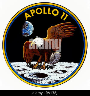 Apollo 11 1969 mission patch featuring the American Bald Eagle delivering an olive branch to the lunar surface as a symbol of the peaceful expedition. The badge was designed collaboratively will the input of the astronauts Neil Armstrong, Buzz Aldrin and Michael Collins. - Stock Photo