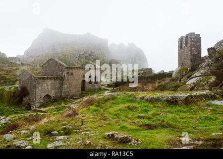 St. Michael's Church In Monsanto village, Portugal. Foggy day - Stock Photo