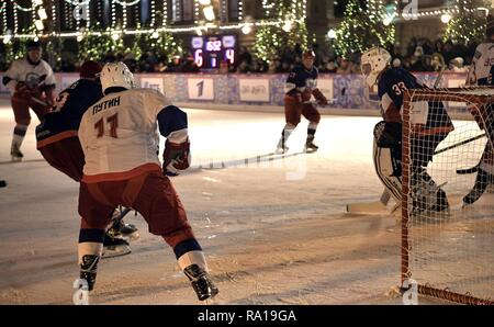 Moscow, Russia. 29th December 2018. Russian President Vladimir Putin #11, left, waits for a shot on goal during ice hockey action at the Night Hockey League match in the rink at the GUM Department store in Red Square December 29, 2018 in Moscow, Russia. Credit: Planetpix/Alamy Live News - Stock Photo
