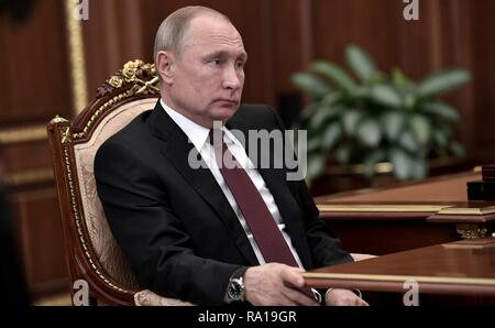 Russian President Vladimir Putin holds a bilateral meeting with the Head of the Russian Direct Investment Fund Kirill Dmitriyev at the Kremlin December 29, 2018 in Moscow, Russia. - Stock Photo