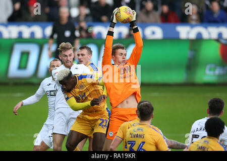 Swanswa, Wales, UK. 29th December 2018. Christian Walton, the goalkeeper of Wigan Athletic saves. EFL Skybet championship match, Swansea city v Wigan Athletic at the Liberty Stadium in Swansea, South Wales on Saturday 29th December 2018.  this image may only be used for Editorial purposes. Editorial use only, license required for commercial use. No use in betting, games or a single club/league/player publications. pic by Andrew Orchard/Andrew Orchard sports photography/Alamy Live news - Stock Photo