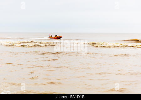 Mablethorpe, Lincolnshire, UK. 30th December 2018. Mablethorpe coastguard practicing maneuvers  in the open sea on the East coast of the UK at Mablethorpe, Lincolnshire on 30/12/2018 RNLI coastguard in boat in the sea in RNLI lifeboat Credit: Tommy  (Louth)/Alamy Live News - Stock Photo