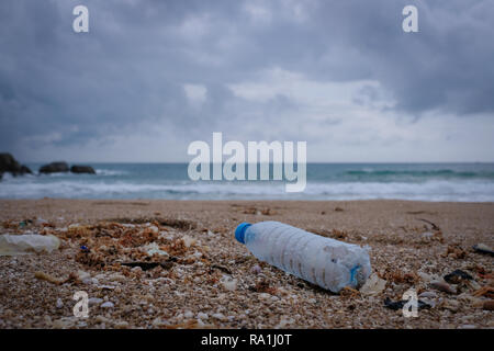 Trash, plastic, garbage, bottle... environmental pollution on the beach. Royalty high-quality free stock photo image of trash, plastic bottle on beach - Stock Photo