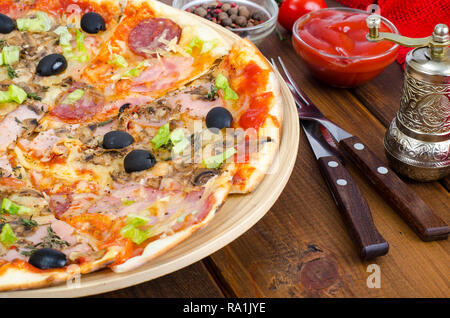 Six slices of pizza with different toppings on wooden board. Studio Photo - Stock Photo