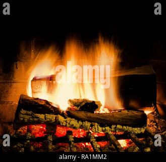 Fire burning bright in fireplace. Isoalted. Stock Image. - Stock Photo