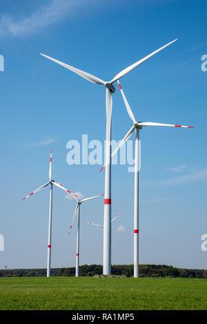 Wind power plants in the fields seen in rural Germany - Stock Photo