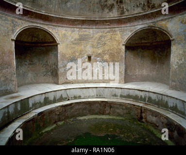 Italy. Pompeii. The Forum thermal baths. Public baths. Edificated immediately after the founding of the colony, they were subdivided into men's and women's section. Room of the Frigidarium (cold pool). Campania. - Stock Photo