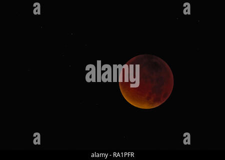 Total Lunar Eclipse of a Supermoon and Blood Moon on September 28th 2015, North Sea, Germany - Stock Photo