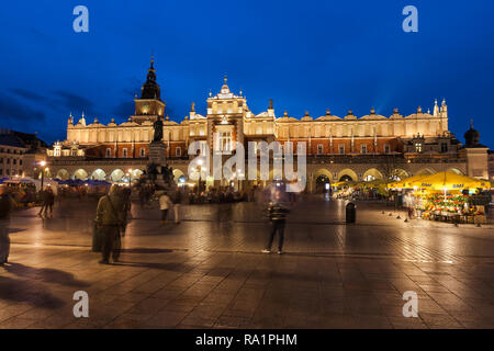 Cloth Hall - Sukiennice illuminated at night at Main Market Square in Old Town of Krakow city in Poland, Europe - Stock Photo