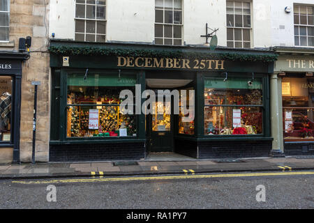 Specialist Christmas decoration shop 'December 25th' in the city of Bath, Somerset, with closing down posters in the window - Stock Photo
