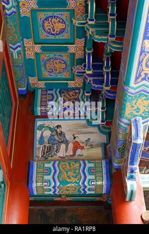 Fresh Gold red and blue painting on the beams of ancient building, Summer Palace, Beijing, People's republic of China. - Stock Photo