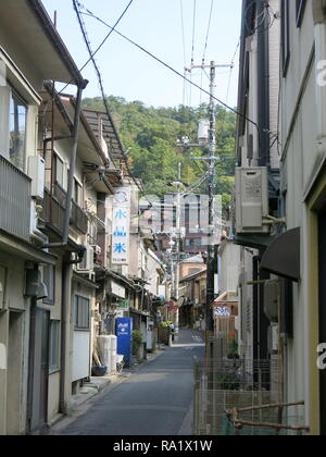 Typical street scene, Miyajima Island, Japan, showing the style of architecture of local houses and shops - Stock Photo