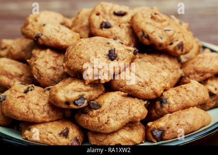 Homemade Pumpkin Chocolate Chip Cookies served on a plate. - Stock Photo