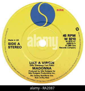 UK 45 rpm 7' single of Like A Virgin by Madonna on the Sire record label from 1984. Written by Billy Steinberg and Tom Kelly and produced by Nile Rodgers. - Stock Photo