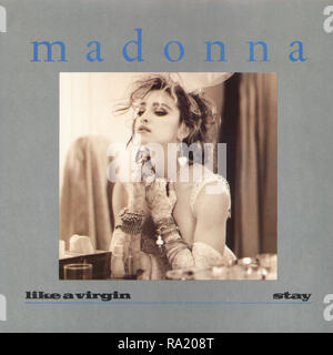 UK 45 rpm 7' single picture sleeve of Like A Virgin by Madonna on the Sire record label from 1984. Written by Billy Steinberg and Tom Kelly and produced by Nile Rodgers. - Stock Photo