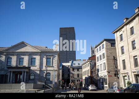 MONTREAL, CANADA - NOVEMBER 4, 2018: Modern skyscraper (500 Place d'armes Building) next to the older houses of Old Montreal, Quebec at fall, a major  - Stock Photo