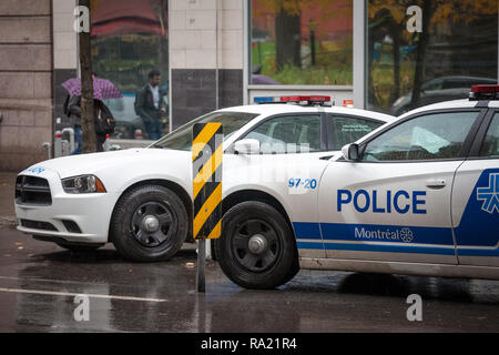 MONTREAL, CANADA - NOVEMBER 5, 2018: Two Montreal Police Service (SPVM) cars standing in front of a local police station. The SPVM is the municipal Mo - Stock Photo