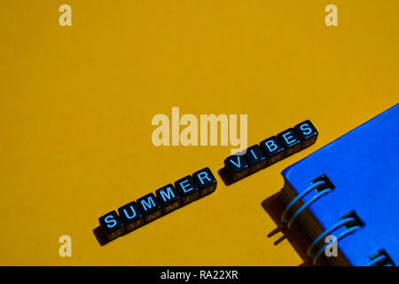 Summer vibes on wooden blocks. business concept on orange background - Stock Photo