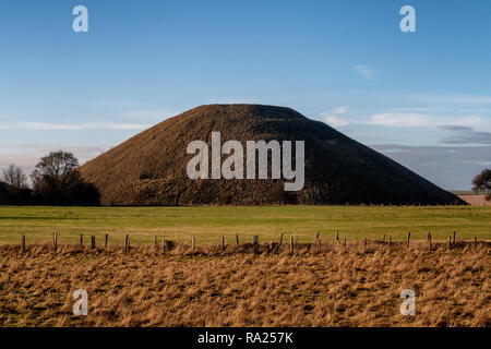 Silbury Hill is a prehistoric artificial chalk mound near Avebury in the English county of Wiltshire. It is part of the Stonehenge, Avebury and Associ - Stock Photo