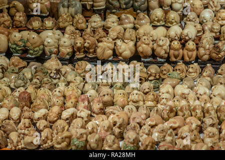 Tagua Nut stall in Hong Kong's Jade Market. The nut, often referred to as 'Vegetable Ivory', is carved into animals, ornaments, and good luck charms. - Stock Photo