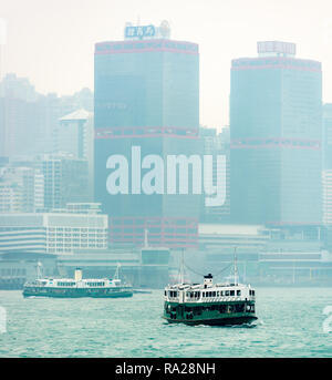The 'Morning Star' ferry plying its trade from Central Ferry piers to Tsim Sha Tsui in Kowloon, Hong Kong. - Stock Photo
