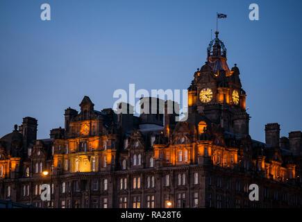 Victorian building, Rocco Forte Balmoral Hotel clock tower lit up at night, Princes Street, Edinburgh, Scotland, UK - Stock Photo