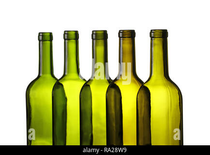 Close up group of five empty washed green glass wine bottles in a row isolated on white background, low angle side view - Stock Photo