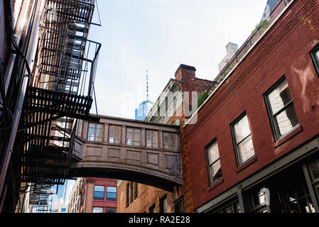 Low angle view of bridge on Staple Street in Tribeca in New York - Stock Photo