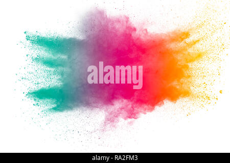 Freeze motion of color powder exploding on white background. - Stock Photo