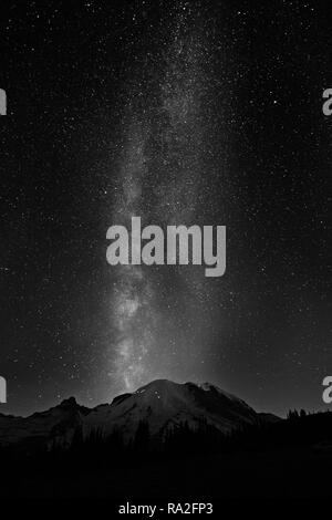WA15644-00...WASHINGTON - The Milkyway over the summit of Mount Rainier from Sunrise in Mount Rainier National Park in black and white. - Stock Photo