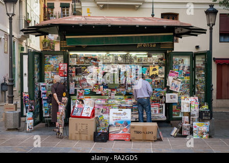 Magazines and newspapers on sale on a newsstand kiosk in the Old Town of Valencia, Spain. - Stock Photo