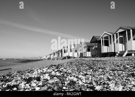 Black and white image of the beach huts at Thorpe Bay, near Southend-on-Sea, Essex, England - Stock Photo