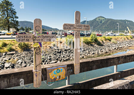 Two crosses form a memorial for two young people who died on the Sing Lee Alley bridge across Hammer Slough in Petersburg, Mitkof Island, Alaska. Petersburg settled by Norwegian immigrant Peter Buschmann is known as Little Norway due to the high percentage of people of Scandinavian origin. - Stock Photo