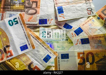 Euro bills harassing the English economy, brexit concept - Stock Photo