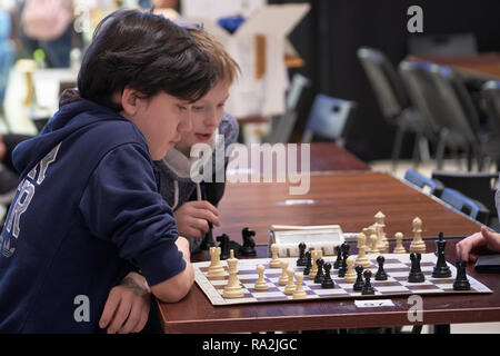 St. Petersburg, Russia - December 28, 2018: Kids playing chess in the hall during World Rapid Chess Championship - 2018. The tournament is supported b - Stock Photo