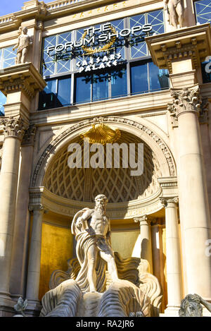 Opulent facade of marble columns with Roman and mythological characters enchant tourists to the upscale Forum Shops at Caesars Palace, Las Vegas, NV - Stock Photo