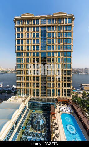 Exterior of the luxurious 5 star Cairo At The First Residence Four Seasons Hotel, Giza, Cairo, Egypt and view of swimming pool on a sunny day