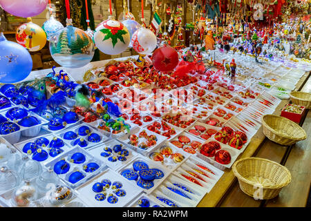 Christmas decorations on sale at a booth of the traditional christmas market of Strasbourg, France, Europe. - Stock Photo