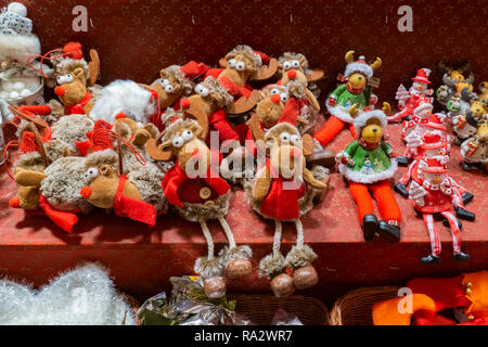 Reindeer cuddly or soft toys on sale on a stall at the Christmas Market of Strasbourg, France, Europe. - Stock Photo